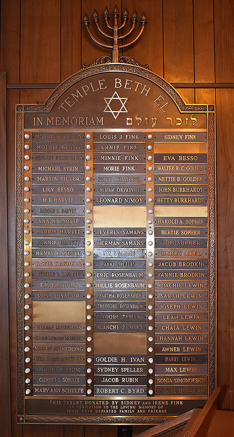 A memorial tablet at Temple Beth El listing the names of the Lewin family.